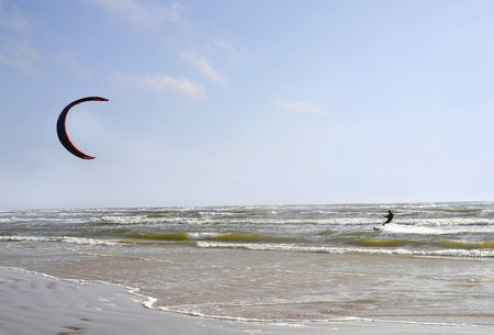 windy: Jurmala (Latvia). Surfing with a parachute (kaitserfing) in windy weather. Stock Photo