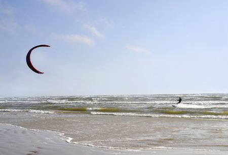 jurmala: Jurmala (Latvia). Surfing with a parachute (kaitserfing) in windy weather. Stock Photo