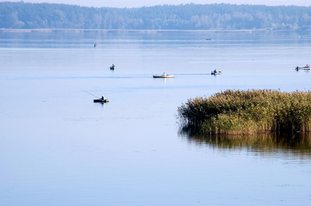Landscape. Morning fishing from the boat on the lake during a calm. Stock Photo
