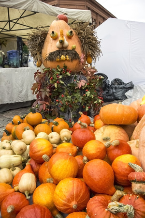 Harvest holiday, Halloween. A sculpture from pumpkins. Stock Photo