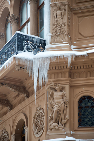 Winter. The big icicles on a building balcony Stock Photo