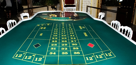 winning location: Casino. A table for the European roulette covered with green felt. Stock Photo