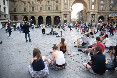 listeners: Florence, Italy - may 17.2015: The guitarists game on the square of Florence in the presence of numerous listeners.