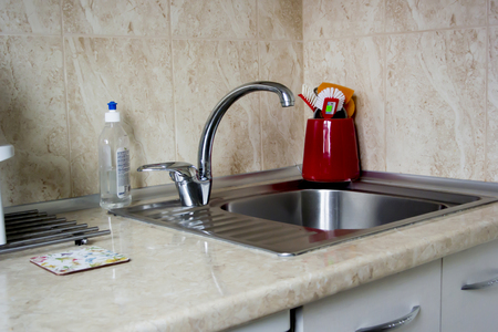 Faucet Sink and water tab decoration in kitchen Stock Photo