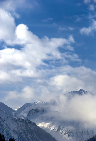View of peaks of mountains and a cloud in the Italian Alps in the winter Stock Photo