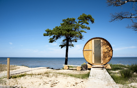 Europe, Latvia, Cape Kolka. House in the form of a barrel on the dunes for the Baltic Sea. View from the door side. Stock Photo