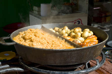 Rural meal. The big frying pan with hot meal