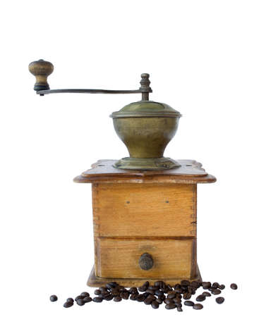 Ancient coffee grinder and the coffee grains isolated on the white