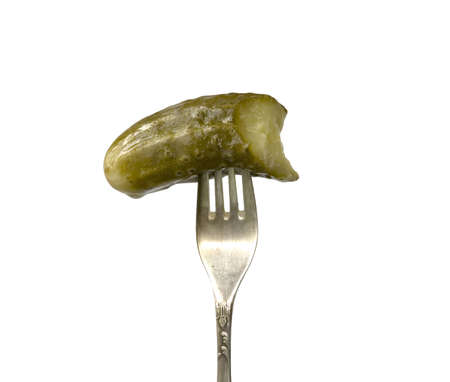 Piece of a pickle on a plug