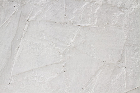 white washed: white washed walls.  Texture uneven whitewashed old wall