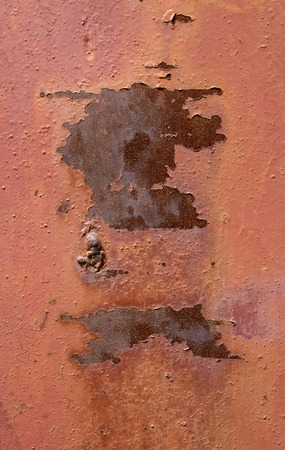 peeling paint: old rusty ply plate with peeling paint terracotta color