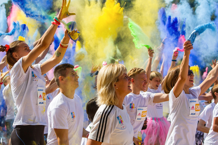 km: Ukraine, Kyiv - 08142016. Kyiv color run. Run 5 km from the colors of Holi. People keep and throw holy colors.