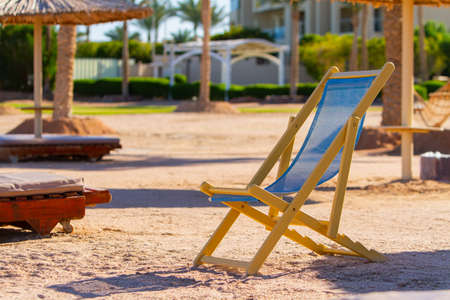 lonely empty sun lounger on the Red Sea beach, evening, winter Sharm El Sheikh, Egypt
