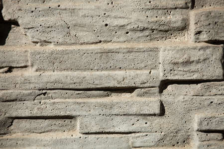 a fragment of a gray figured concrete wall