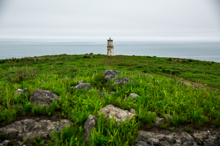 Lighthouse centered on the background of the sea in cloudy weather Stock fotó