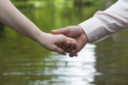 young couple doing handshake in the park Stock Photo - 14902019