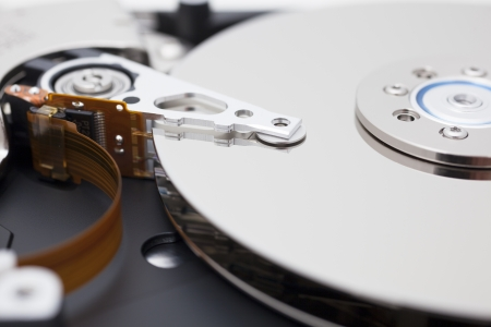 Close up of opened hard disk drive, data saving  Stock Photo - 15910344