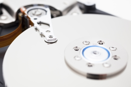Close up of opened hard disk drive, data saving