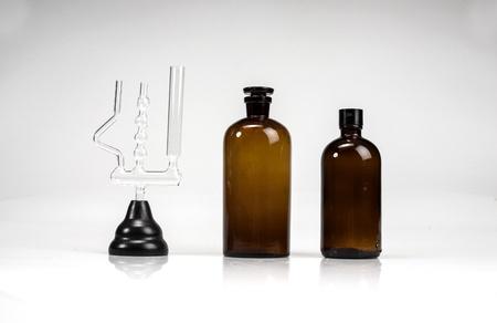 Pharmacy bottles and test-tubes on white background Stock Photo - 16560322