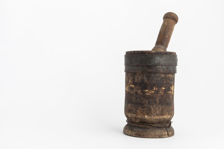 Mortar and pestle closeup in studio on white background
