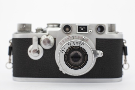 vintage old photographic rangefinder camera with white background