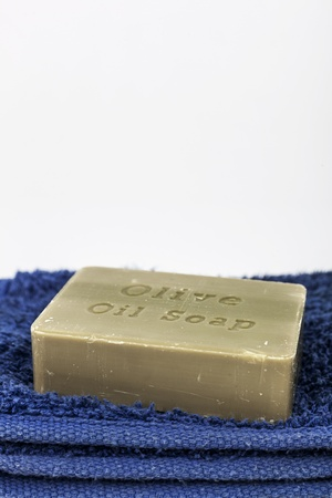 Olive oil soap on a blue towel