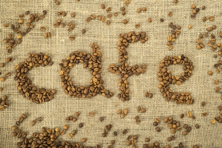 Word cafe made with coffee beans on burlap.