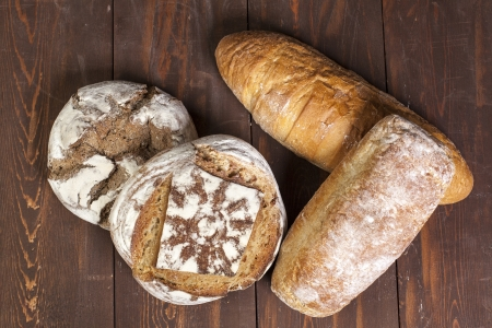 fresh traditional bread on a wooden table Stock Photo