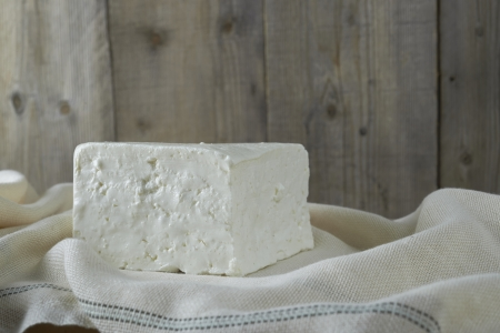 cube of fresh feta cheese on a  cheesecloth Stock Photo