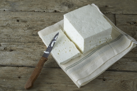 cubed: cube of fresh feta cheese just cut with knife on a  cheesecloth