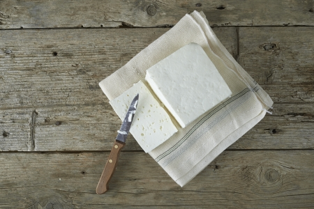 cubed: cube of fresh feta cheese on a  cheesecloth Stock Photo