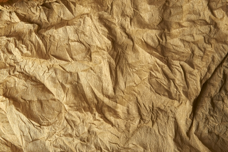 Brown color crumpled paper as a background Stock Photo - 22523618