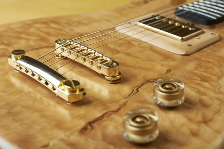 boehm flute: Guitar, wooden natural color with golden accessories. Stock Photo