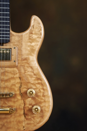 boehm: Guitar, wooden natural color with golden accessories. Stock Photo