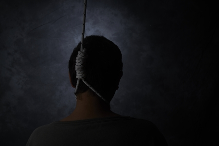gallow: suicide, depressed man with a noose around his neck Stock Photo