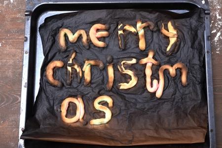 merry christmas cookies in pan, burned up photo