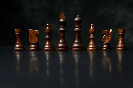 wooden chess pieces. photo