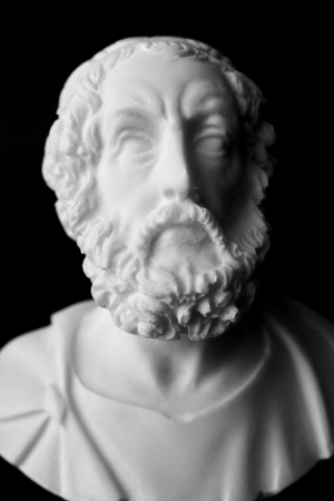 statues: Homer is the author of the poems, Iliad and Odyssey known as Homeric Epics.  White marble bust of the greek poet.