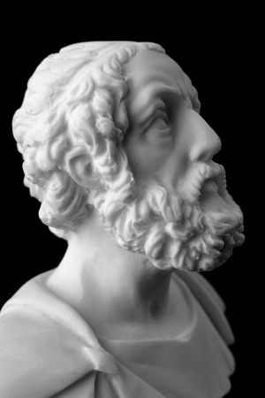 Homer is the author of the poems, Iliad and Odyssey known as Homeric Epics.  White marble bust of the greek poet.