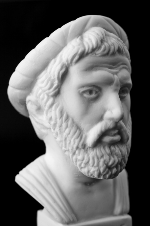 Pythagoras of Samos, was an important Greek philosopher, mathematician, geometer and music theorist.  White marble bust. Stock Photo