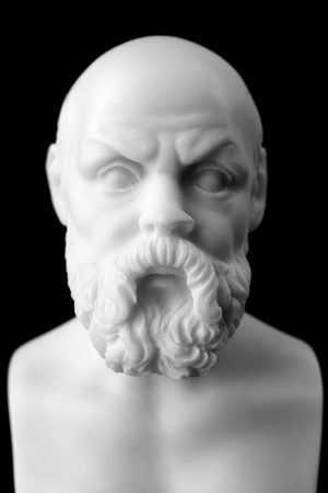 Socrates lived in Athens (470 BC - 399 BC) was a Greek Athenian philosopher is one of the most important figures in the world. It is one of the founders of Western philosophy.  White marble bust of him. Stock Photo
