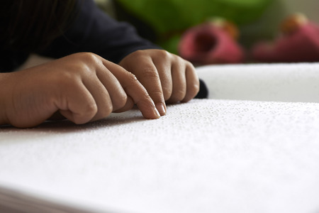 blind children read text in braille language