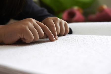 braille: blind children read text in braille language