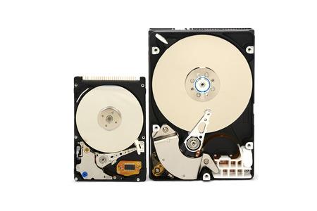 electronics parts: Close up of opened hard disk drive, data saving.
