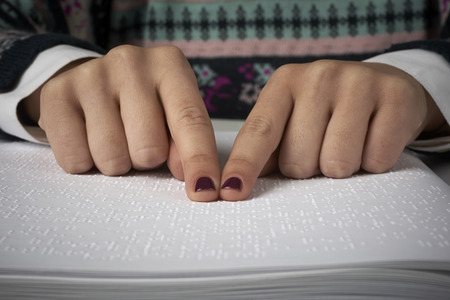 Blind woman reading text in braille language Stock Photo - 25924280