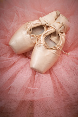 pair of ballet shoes pointes with ribbons on wooden floor Stock Photo