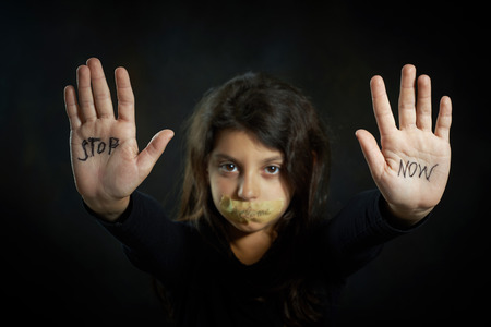 Children violence  Stop now are write on extended girl Stock Photo