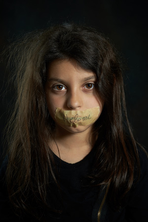 Help me  Disheveled girl with taped mouth  photo