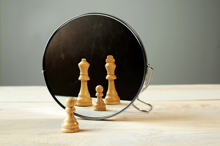chessmen: You are not alone. Chessmen in front of the mirror