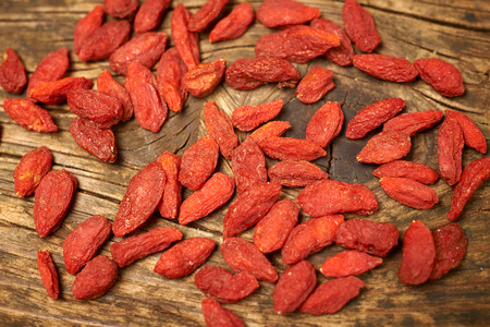 goji berry fruits, on a wooden table photo
